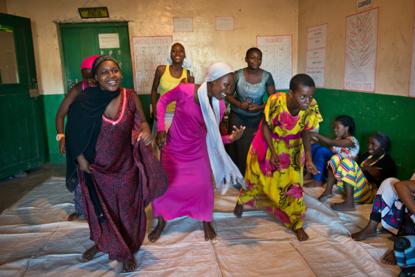 Photo courtesy of BRAC. Members of an ELA girls club perform a dance about AIDS.