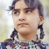 An Adolescent Balochi Girl in her traditional Balochi Jewelry and Dress.  Shot at Baloch Culture day, Quetta.